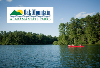 two people canoeing on the lake at oak mountain state park